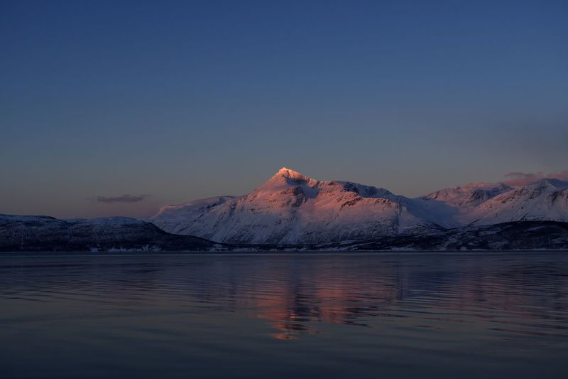 First light Tromsø Norway EyeEmNewHere Betterlandscapes Tromsø Norway Mountain Sky Water Beauty In Nature Scenics - Nature Tranquil Scene Tranquility Snow Waterfront Winter Cold Temperature Nature Reflection Copy Space Mountain Range Snowcapped Mountain