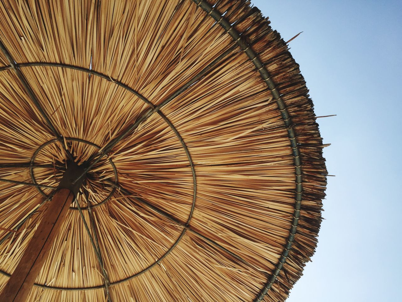 Low Angle View Of Thatched Roof Parasol Against Sky