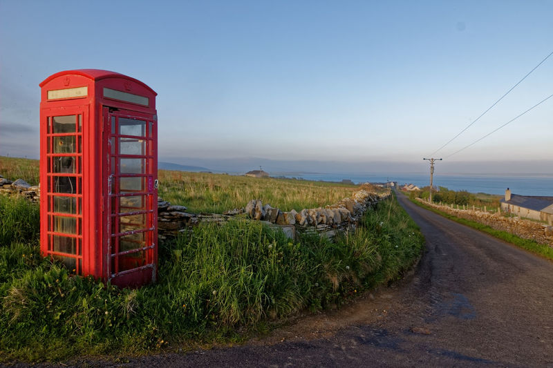 Red Phone Box, Orkney Islands Icon Orkney Islands Red Phone Box Scotland Blue Communication Connection Day Grass Iconic Land Nature Outdoors Pay Phone Plant Red Red Phone Sky Technology Telecom Telephone Telephone Booth Tourism Travel Destinations Vivid International