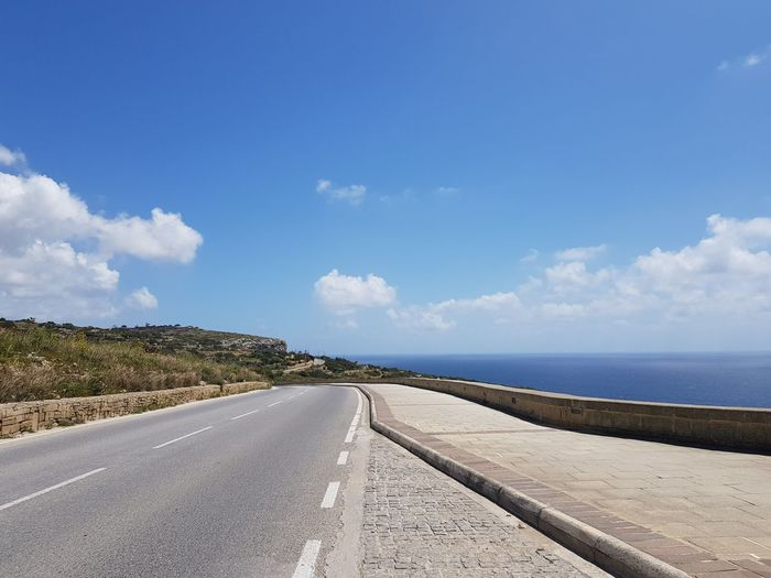 road Road Malta Medeteranian Sea Mediterranean  No Filter No Edit Water Sea Blue Road Summer Sunny Sky Landscape Cloud - Sky Country Road Diminishing Perspective Empty Road The Way Forward