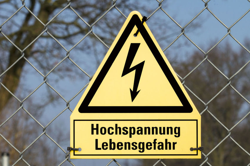Yellow sign high voltage Danger to life Communication Danger Day Electricity  Electricity  No People Outdoors Safety Shield Text Voltage Warning Sign Yellow