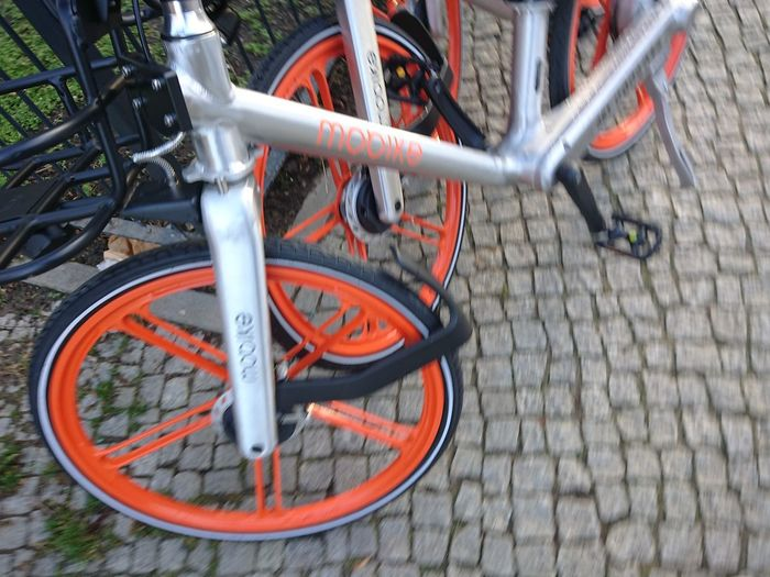 Berlin, Germany - February 1, 2018: Mobike bike. founded and owned by Beijing Mobike Technology, Mobike is a fully station-less bicycle-sharing system headquartered in Beijing, China Mobike Bicycle Bicycle Bicycle Parking Bicycles Bicycling Bike Share Bike Sharing Bike-share Bike-sharing Chinese Close-up Editorial  Land Vehicle Metal Mobike Mode Of Transport No People Outdoors Parking Spoke Stationary Street Transportation Two Wheels Wheel