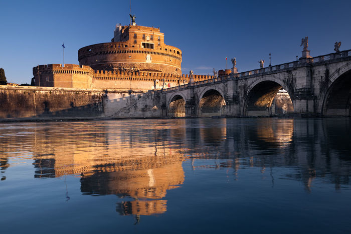 Castel Sant'Angelo, Rome, Italy Castel Sant'Angelo Roma Arch Arch Bridge Architecture Bridge Bridge - Man Made Structure Building Exterior Built Structure City Clear Sky Connection History Nature Outdoors Reflection River Sant'angelo Sky The Past Tourism Travel Travel Destinations Water Waterfront