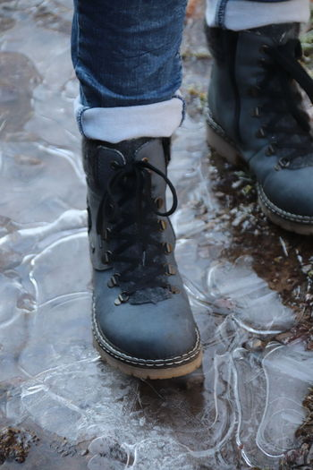 Low Section Shoe Human Leg Body Part Human Body Part Lifestyles Standing Real People People Unrecognizable Person Boot Day Leisure Activity High Angle View Outdoors Human Foot Women Two People Adult Leather Rubber Boot Jeans Human Limb