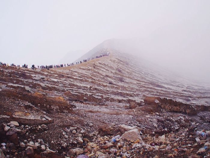 Tourists On Peak Of Mountain In Foggy Day