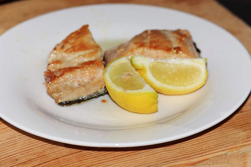 Pan fried pink salmon with wedges of lemon Fried Fish Fried Food Fried Salmon Fish Pink Salmon Salmon - Seafood EyeEm Selects Plate Food Food And Drink Freshness Ready-to-eat Healthy Eating Indoors  Fruit Wellbeing Close-up Still Life Table No People SLICE Indulgence Citrus Fruit Serving Size Sweet Food Temptation Lemon