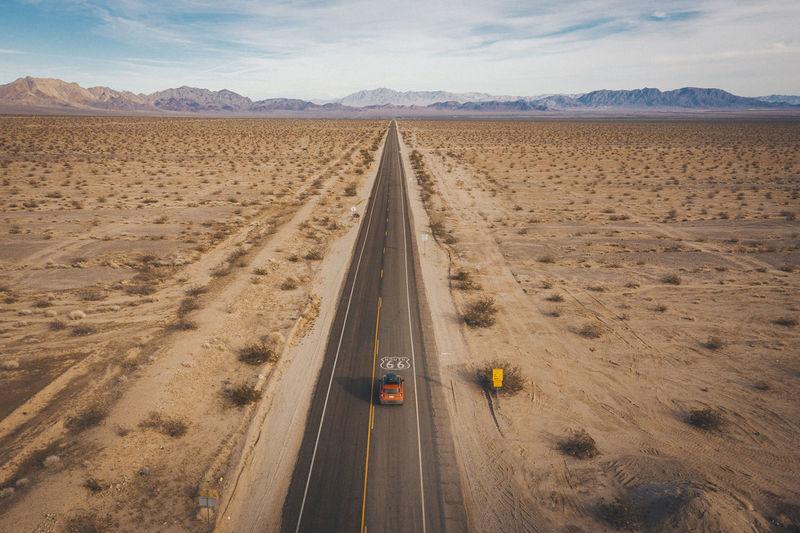Panoramic view of road passing through desert
