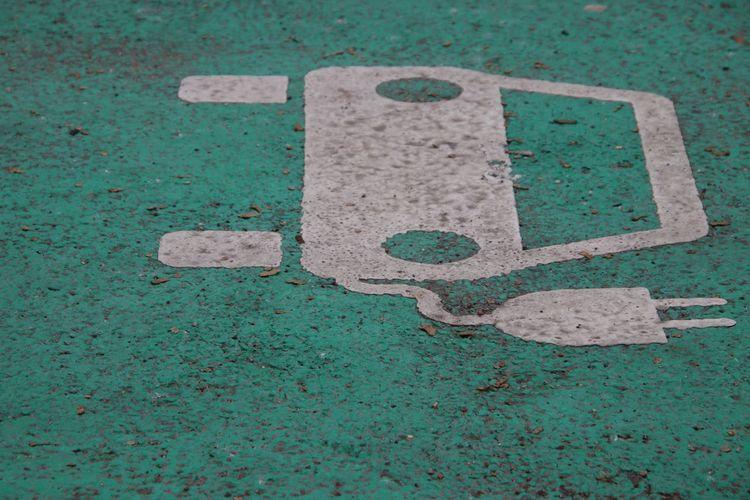 Full frame shot of electric car sign on street