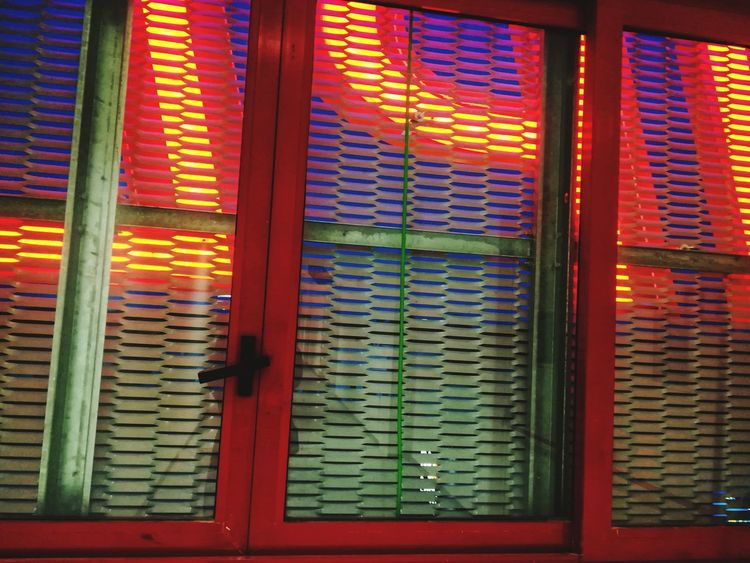 Motel Sign Grate In Front Of The Window Glass - Material Grate In Front Of The Window Protection Grille Luminous Writing Multi Colored No People Window Day Pattern Indoors  Architecture Red Blinds Close-up Full Frame