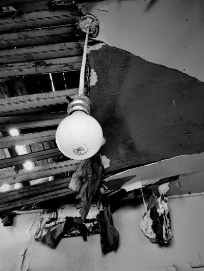 """""""Last Bulb Hanging"""" A single, bare, light bulb dangles from the decaying ceiling of an abandoned old house in the Village of Corona, New Mexico. Rural Decay Ruraldecay Abandoned & Derelict Abandoned Buildings Lightbulb Blackandwhite Photography Old Buildings Newmexicophotography Deserted House"""