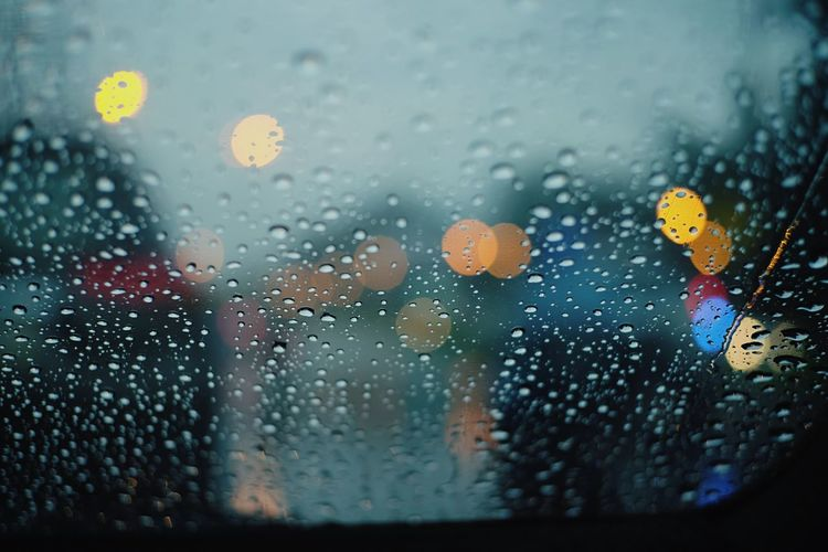 Rainy Season Traffic Light  Wet Drop Glass - Material Window Water Rain Transparent Rainy Season Glass Close-up Indoors  Vehicle Interior Mode Of Transportation Motor Vehicle Transportation RainDrop No People Land Vehicle Car