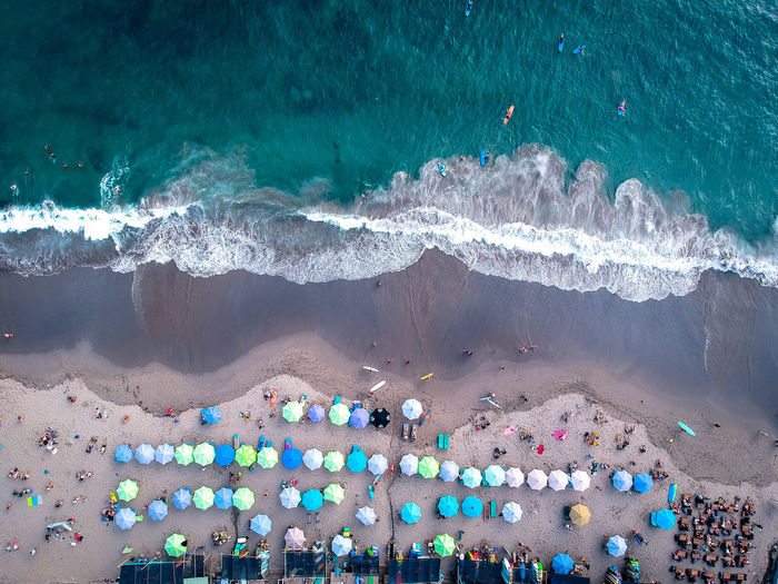 Aerial Drone view at Batu Bolong Beach, Cangu, Bali Water Sea Beach Land High Angle View Sand Wave Motion Nature Holiday Aquatic Sport Surfing Architecture Scenics - Nature Aerial View Vacations People Day Sport Outdoors Turquoise Colored Pollution Aerial Photography Aerial Shot Aerial Landscape Dronephotography Droneshot Drone View