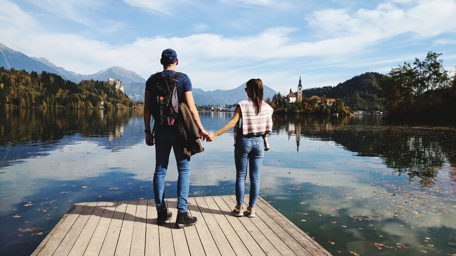 Two People Adults Only Heterosexual Couple Adult Togetherness Young Adult Young Women People Men Vacations Standing Young Men Full Length Reflection Women Young Couple Day Couple - Relationship Leisure Activity Lake Slovenia Bled Autumn Nature Adults Only