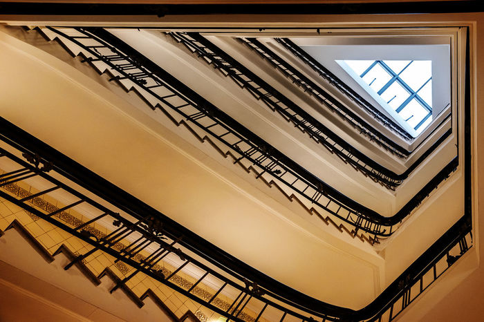 Old triangular spiral stairway case from below Architecture Stairs Below Built Structure Day Historic Indoors  Low Angle View Metaphor No People Old Railing Spiral Staircase Stairways Steps Steps And Staircases Sucsess Symbol Triangle Upwards