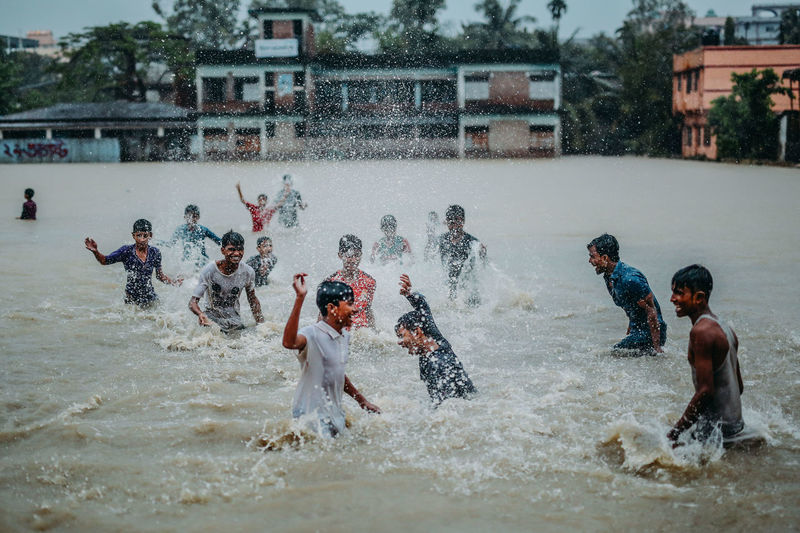 Fun in the Flood Architecture Boys Building Exterior Built Structure Childhood Chittagong Competitive Sport Day Enjoyment Flood Fun Leisure Activity Lifestyles Men Motion Nature Outdoors Playing Real People Splashing Spraying Tidal Flood Water Water Park Water Slide