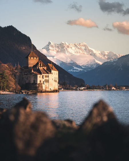 Mountain Built Structure Architecture Water Building Exterior Sky Building Cloud - Sky Mountain Range Lake Nature Beauty In Nature Scenics - Nature No People House Focus On Background Day Outdoors Residential District Castle Chateau De Chillon Geneva