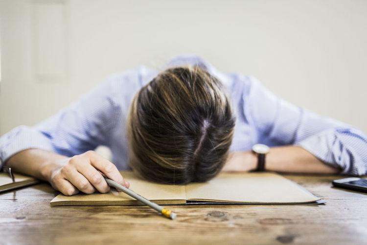 Portrait of girl sleeping on table
