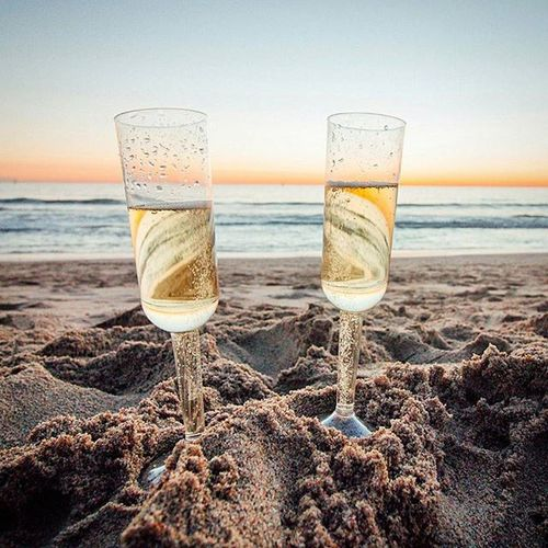 Throwback to celebrating our two year with some Veuveclicquot on the beach. @lizzypal Thegoodlife Imbrokenow
