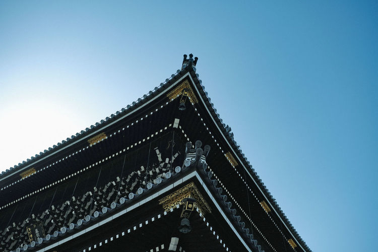 Low angle view of temple building against clear sky