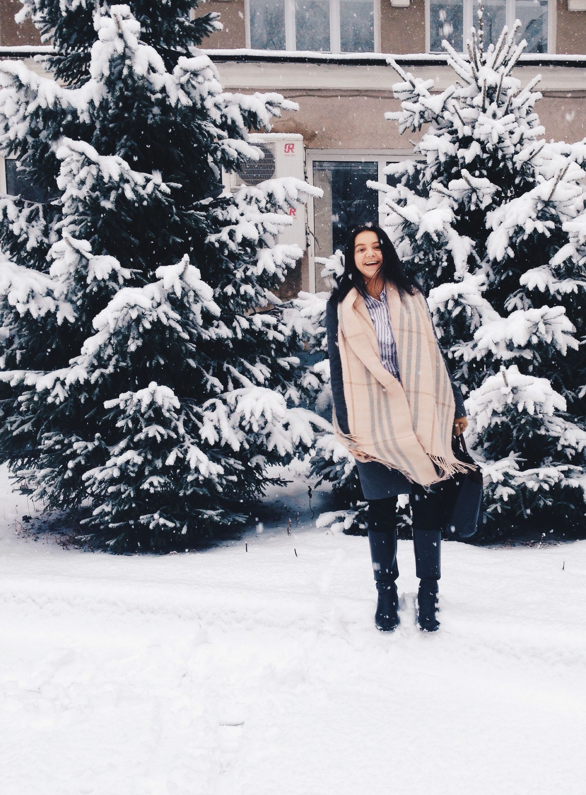 winter, snow, cold temperature, season, lifestyles, warm clothing, building exterior, weather, leisure activity, full length, covering, architecture, front view, white color, built structure, person, casual clothing, standing