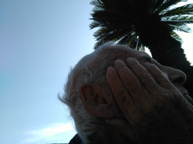 -The hand that faced them all- Headshot Blue Tree Day Outdoors Palm Tree Close-up Nature Sky Only Men Best EyeEm Shot Best Of EyeEm Happiness Sunlight Tranquility Freshness Fragility Adults Only Adult One Man Only One Person Grandfather Grandad Second Acts Be. Ready. EyeEm Ready