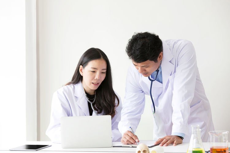 Doctors discussing on table at