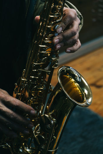 Cropped Image Of Musician Playing Saxophone
