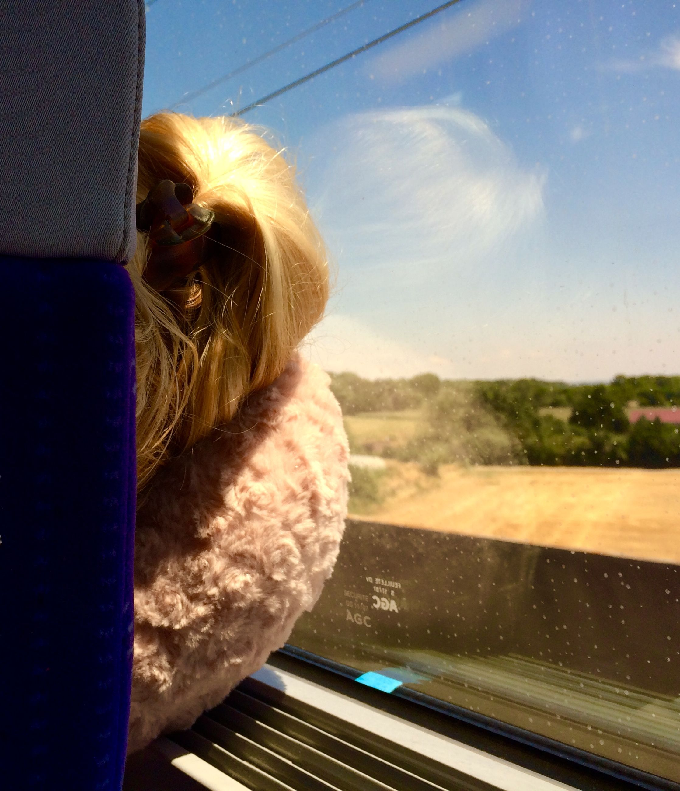 transportation, sky, window, glass - material, transparent, car, side view, looking through window, sunlight, lifestyles, rear view, railroad track, day, land vehicle, leisure activity, travel, looking away, mode of transport