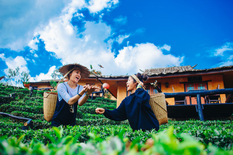 Sky Plant Cloud - Sky Nature Real People Leisure Activity Two People Casual Clothing Day Adult Lifestyles Men Field Land Architecture Grass Sitting Togetherness Young Adult People Outdoors Surface Level