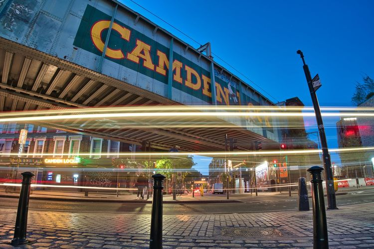 Camden Buzz Architecture Transportation Building Exterior Illuminated Built Structure Motion Sign City Footpath Nature Blurred Motion Street Sky Blue Outdoors Mode Of Transportation Sidewalk Text Street Light Dusk Light Camden Camden Town Camden Lock London LONDON❤ London Streets Street Photography Trails Light Trail Light Trails City Lights Posts Bollards Bridge - Man Made Structure Illumination Fast Buzzing
