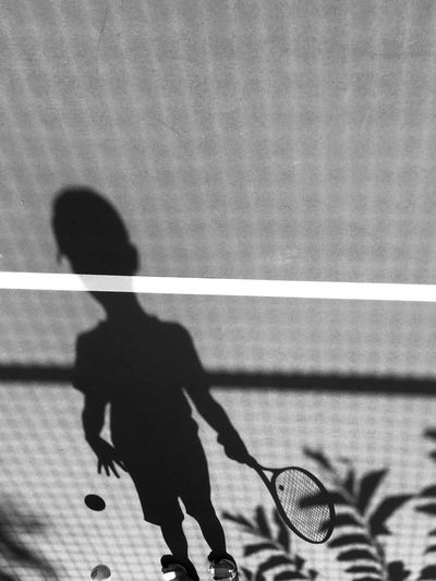 Shadow Of A Boy Playing Tennis