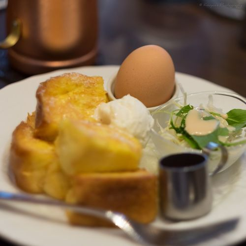 Close-up of french toast with egg served in plate