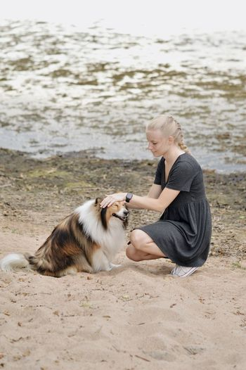 Young woman with dog on beach