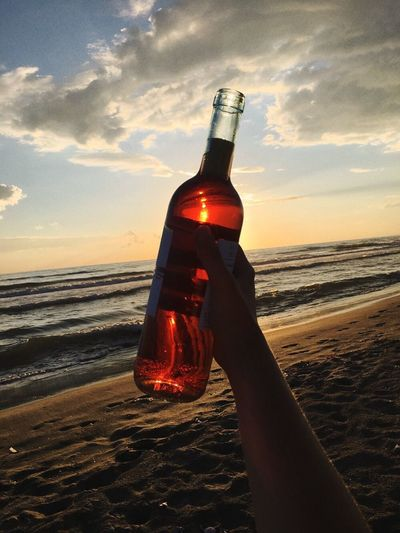 Catching Napoli's sun Calm Happiness Sea Rose Vine Bottle Container Alcohol Water Sea Beach My Best Travel Photo Drink Sky Holding Food And Drink Sunset Cloud - Sky Refreshment My Best Travel Photo