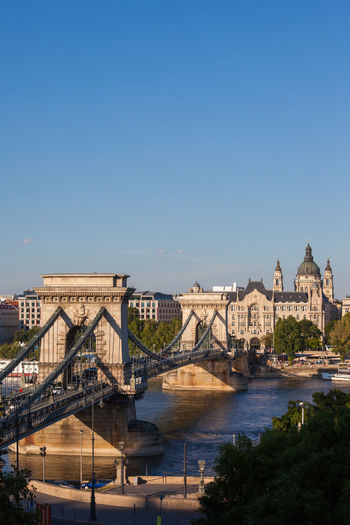 Chain Bridge (Szechenyi lanchid) on Danube river in city of Budapest, Hungary. Budapest Hungary Chainbridge Bridge - Man Made Structure Bridge Danube River Architecture Built Structure Building Exterior Water Connection Travel Destinations Transportation Chain Bridge Arch Bridge Danube River Cityscape Landmark Monument Clear Sky Copy Space