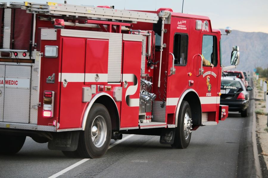 Emergency response vehicles arriving on the side of highway 62 at the scene of a rollover vehicle accident. Accidents And Disasters Coachella Valley Emergency Response Emergency Vehicles Fire Department Fire Engine Fire Truck Outdoors Police Red Riverside County Rollover Accident Safety