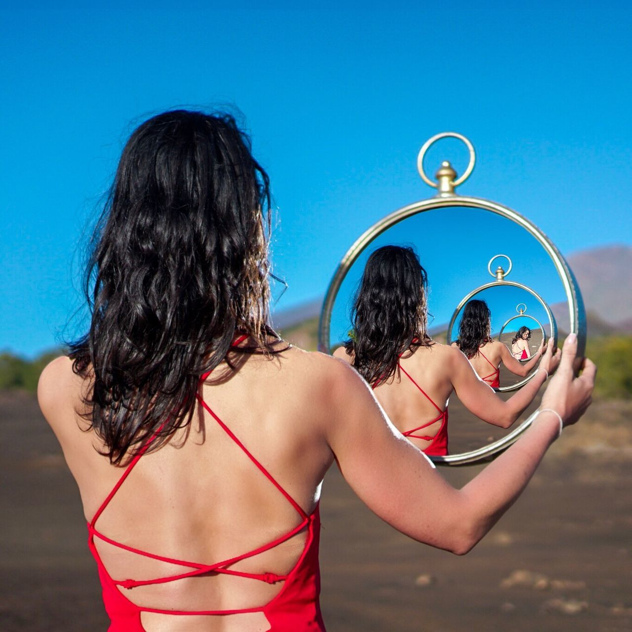 REAR VIEW OF FRIENDS STANDING AT BEACH AGAINST BLUE SKY