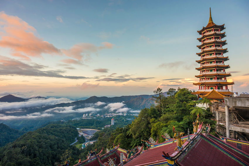 Sunrise at a Taoist Temple Architecture Building Exterior Built Structure Business Finance And Industry Chinese Architecture City Cityscape Cloud - Sky House Of Worship Kuala Lumpur Malaysia Outdoors Place Of Worship Politics And Government Religion Road Scenics Sky Skyscraper Taoism Temple Tourism Travel Travel Destinations Urban Skyline