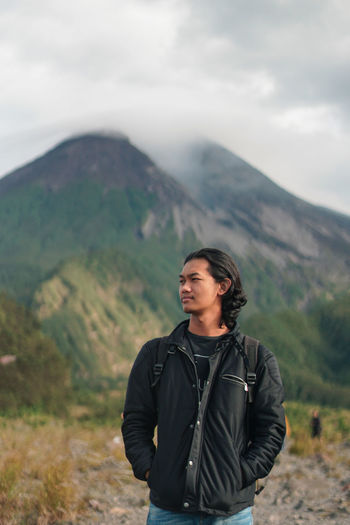Portrait of man with volcano background