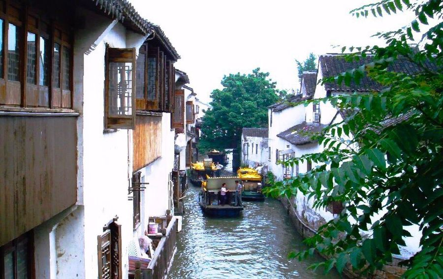 Suzhou Suzhou, China Building Exterior Architecture Travel Destinations House Outdoors Built_Structure City Cityscape Day Vacations No People Nautical Vessel Water Sky Gondola - Traditional Boat Let's Go. Together.