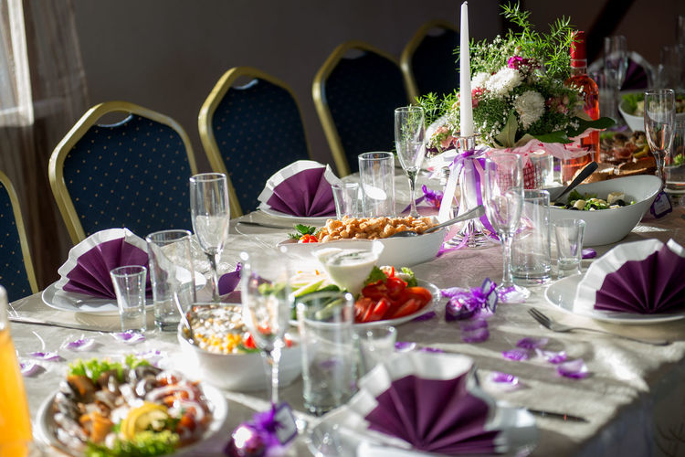 Close-up of food with place setting on table