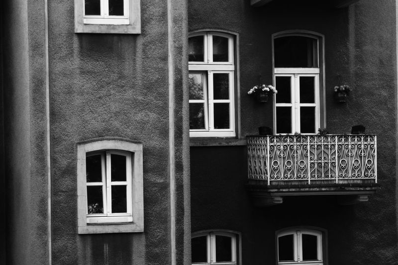 Windows to the world Ajar Renovation Real Estate Development Marketing Windowside In Front Housing Real Estate Real Estate Market Apartments Flats Gentrification Accommodation Balcony View Black And White Façade White Frame Floor Old Buildings Nobody Around Window Window Box Residential Building House Architecture Building Exterior Built Structure Closed Window Frame