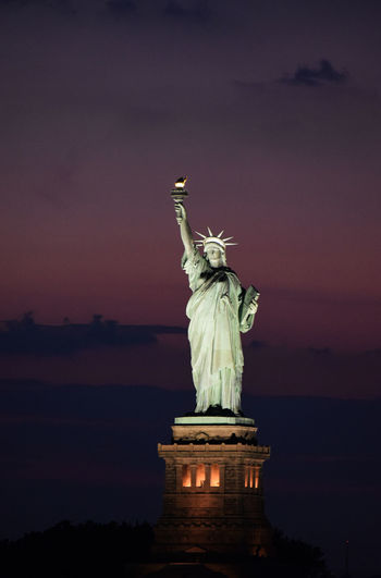 Statue of liberty against sky at dusk