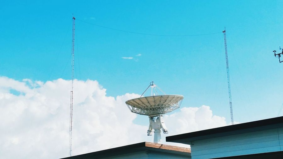 Satellite Satellite Dish Telecommunications Equipment Broadcasting Communication Antenna - Aerial Sky Global Communications Tower Blue Technology Wireless Technology Connection Low Angle View Nature Outdoors Television Aerial No People Satellite Day Internet
