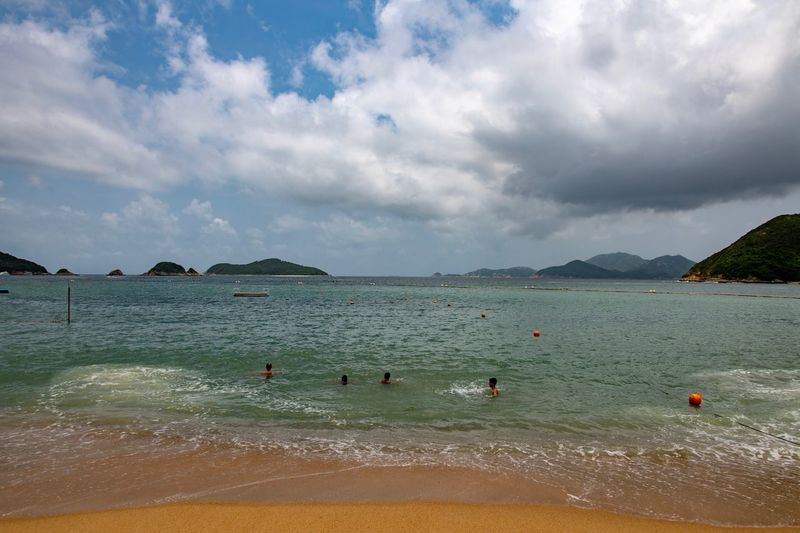 Swimming in Repulse Bay Water Cloud - Sky Sky Sea Beauty In Nature Land Beach Nature Scenics - Nature Tranquility Swimming Day Tranquil Scene Incidental People Group Of Animals Mountain Outdoors Holiday Summer Sports