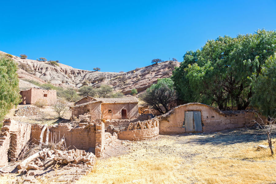 Ruins of a small adobe village near Tupiza, Bolivia Adobe Arid Arid Climate Beauty In Nature Bolivia Cactus Canyon Countryside Desert Formation Formations Landscape Red Rock Rocks Rugged Ruins Rural Sky South America Tourism Travel Travel Destinations TUPIZA Village