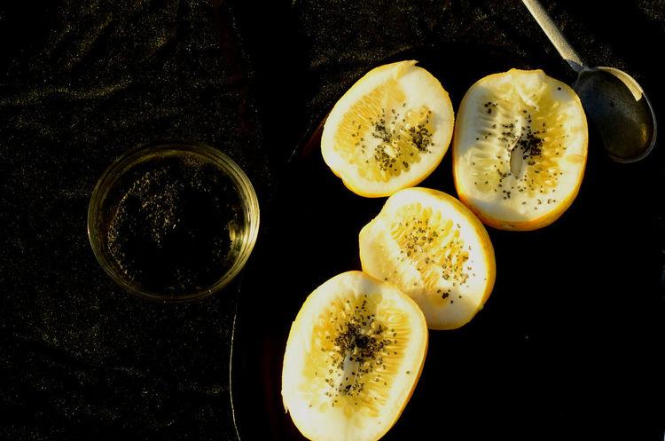 Black Hawaiian salt sprinkled over yellow cucumber halves Eating Food And Drink Black Hawaiian Salt Close-up Day Food Food And Drink Freshness Healthy Eating Healthy Food Indoors  No People Salt - Mineral Seasoning Vegetable Yellow Cucumber