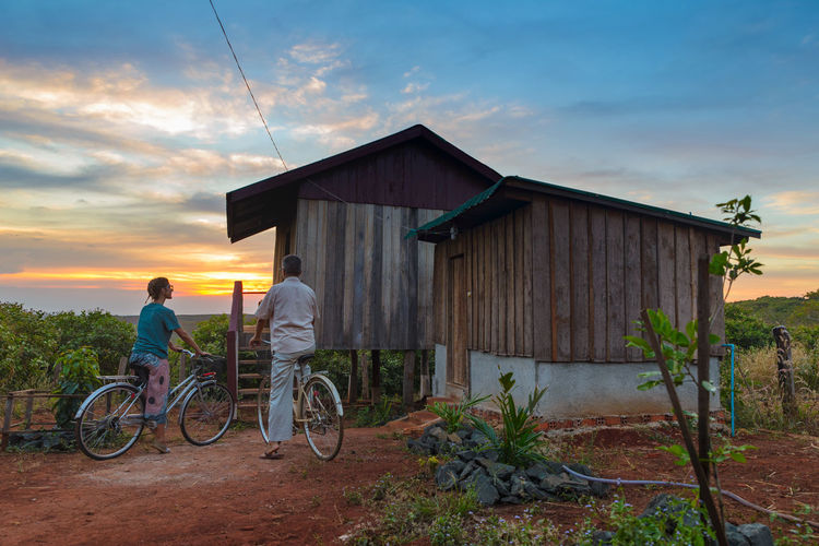 Sky Architecture Bicycle Built Structure Transportation Building Exterior Men Two People Sunset Real People Cloud - Sky Nature People Mode Of Transportation Land Vehicle Lifestyles Leisure Activity Building Outdoors House