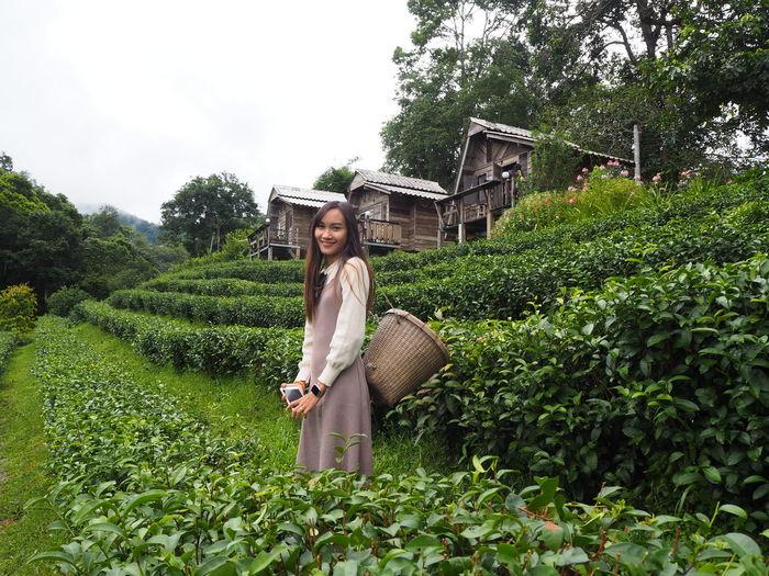 Portrait of young woman at tea plantation