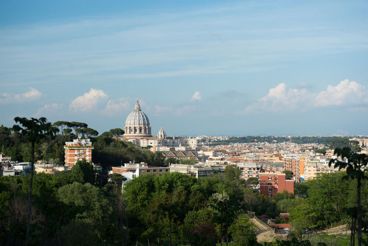 High Angle View Of St Peter Basilica Dome Amidst City Against Sky